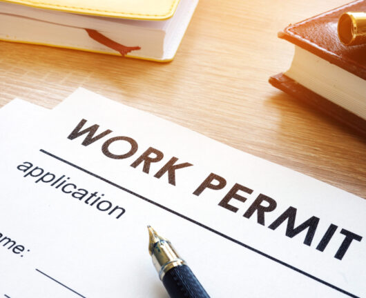 Work permit application on a table.